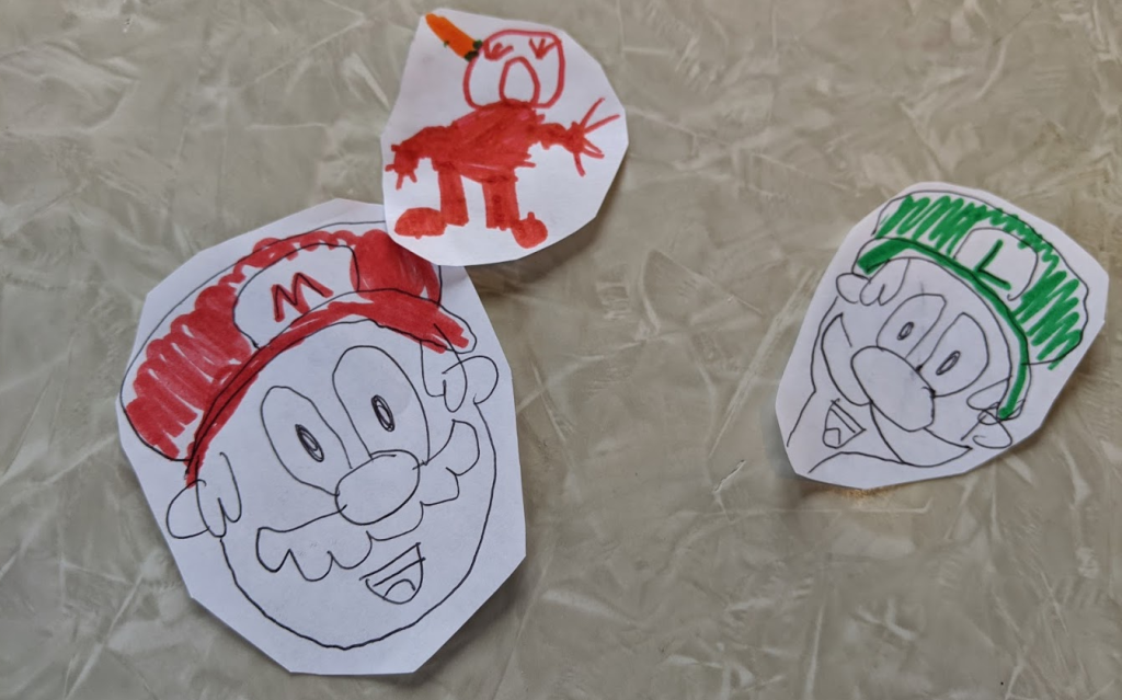 Left to right: Mario, Pom Pom, Luigi